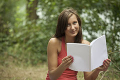 Young woman holding magazine Stock Photography