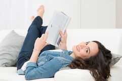 Young Woman Holding Magazine Royalty Free Stock Photos
