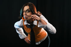 Young Woman holding Magnifying Glass Stock Photos