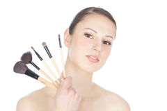 Young woman holding make-up brushs Royalty Free Stock Photo