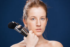 Young woman holding makeup brushes Stock Image