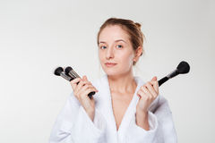 Young woman holding makeup brushes Stock Photo