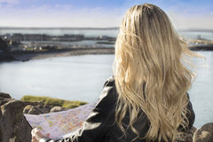 Young woman holding a map. Young woman looking the landscape holding a map Royalty Free Stock Photography