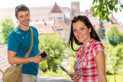Young woman holding map man with camera Royalty Free Stock Photos