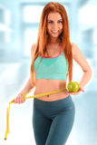 Young woman holding measure tape and apple. Weight loss Stock Photo