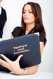 A young woman holding a menu card and a waitress Royalty Free Stock Photo