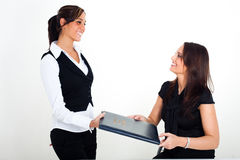 A young woman holding a menu card and a waitress. A young woman in a restaurant, holding a menu card in her hands Stock Photos