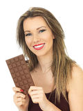 Young Woman Holding a Milk Chocolate Bar Royalty Free Stock Images