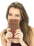 Young Woman Holding a Milk Chocolate Bar Royalty Free Stock Photography