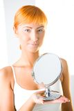 Young woman holding mirror Stock Image