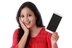Young woman holding mobile phone against white Stock Photos