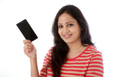 Young woman holding mobile phone against white Royalty Free Stock Photos