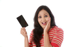 Young woman holding mobile phone Stock Image