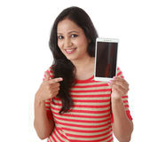 Young woman holding mobile phone against white Royalty Free Stock Photo