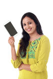 Young woman holding mobile phone Stock Images