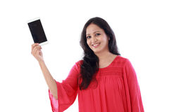 Young woman holding mobile phone against white Royalty Free Stock Photography