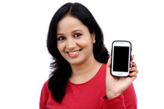Young woman holding mobile phone Royalty Free Stock Photos
