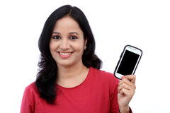 Young woman holding mobile phone Royalty Free Stock Images