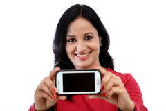 Young woman holding mobile phone Stock Photo