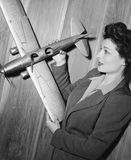 Young woman holding a model plane Stock Photo