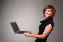 Free Young Woman Holding Modern Laptot Stock Photography - 32260222