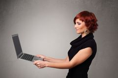 Young woman holding modern laptot Stock Photography