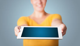 Young woman holding modern tablet Stock Photos