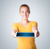 Young woman holding modern tablet Royalty Free Stock Photography