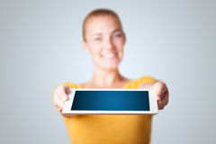 Young woman holding modern tablet Royalty Free Stock Image