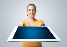 Young woman holding modern tablet Stock Photography