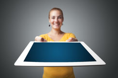 Young woman holding modern tablet Stock Images