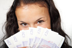 Young woman holding money Stock Image