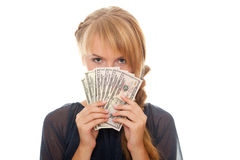 Young woman holding money in the face Royalty Free Stock Photo