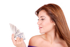 Young woman holding money in the hand Stock Photos