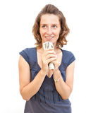 Young woman holding money in hands. Young smiling woman holding money in hands isolated over white Stock Images