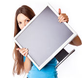 Young woman is holding monitor Stock Photos