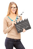Young woman holding a movie clap stock photos