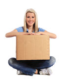 Young woman holding moving box Stock Images