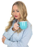 Young Woman Holding a Mug of Coffee Stock Image