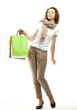 Young woman holding multicolored paper bags Stock Image