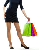 Young woman holding multicolored paper bags Stock Images
