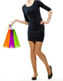 Young woman holding multicolored paper bags Royalty Free Stock Images