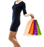 Young woman holding multicolored paper bags Stock Photography