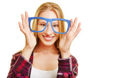 Young woman holding nerd glasses Royalty Free Stock Photography