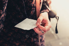 Young woman holding a note royalty free stock photo