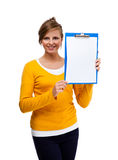 Young woman holding notepad Royalty Free Stock Photos