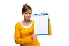 Young woman holding notepad Royalty Free Stock Image