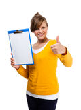 Young woman holding notepad showing ok sign Royalty Free Stock Photo