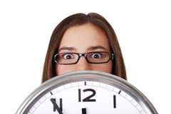 Young woman holding office clock Royalty Free Stock Photos