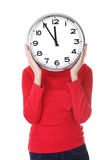 Young woman holding office clock Stock Image